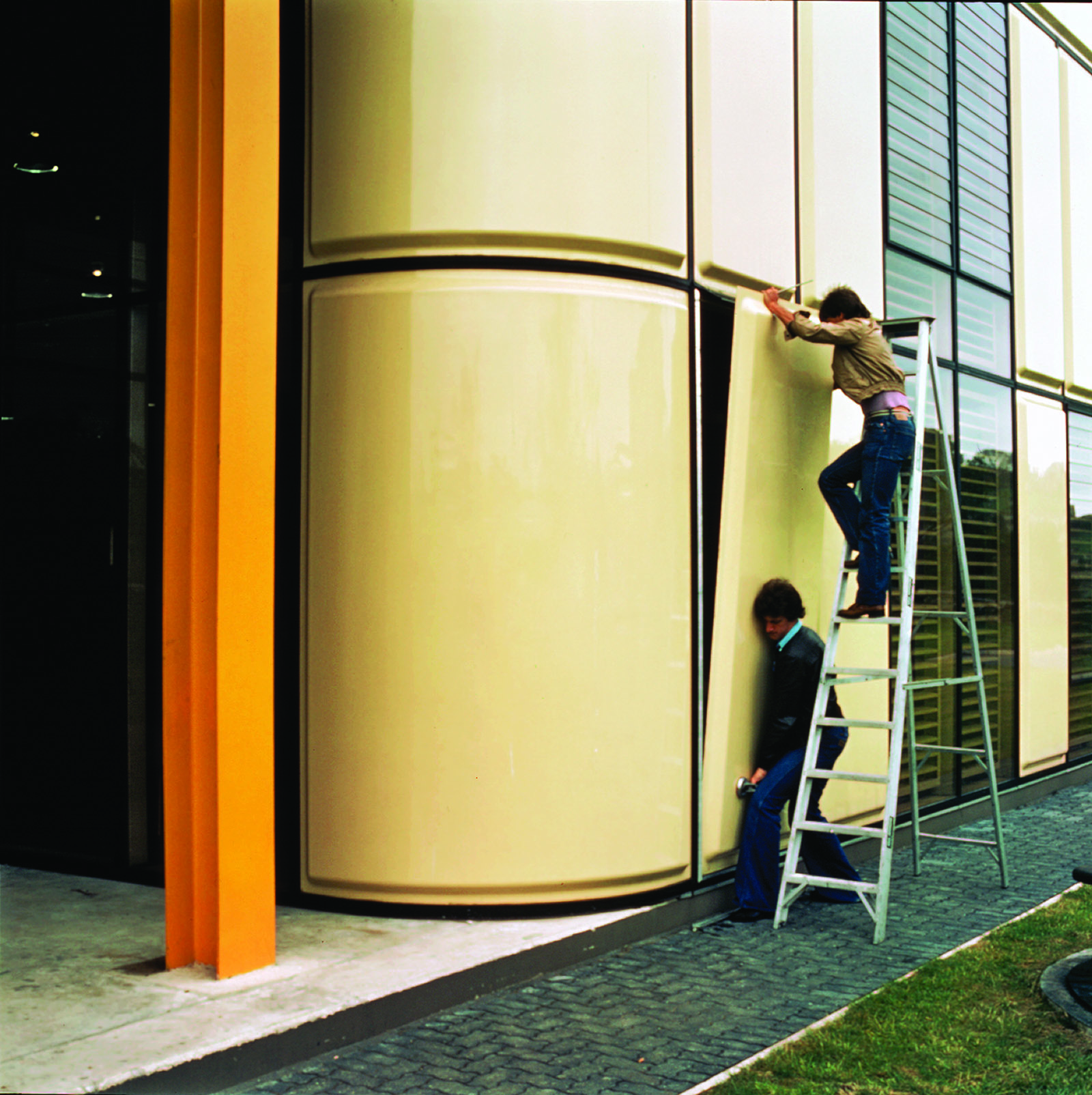 Beige fibreglass panels making up the facade of the Bath Schools of Art and Design, formerly the Action Factory, are installed in 1976