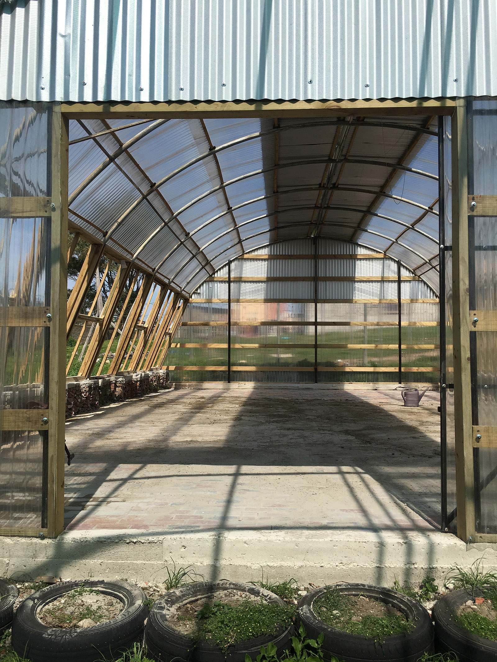 The training hall of the Lim'uphile Co-op by Collectif Saga is made from recycled tubular steel arches