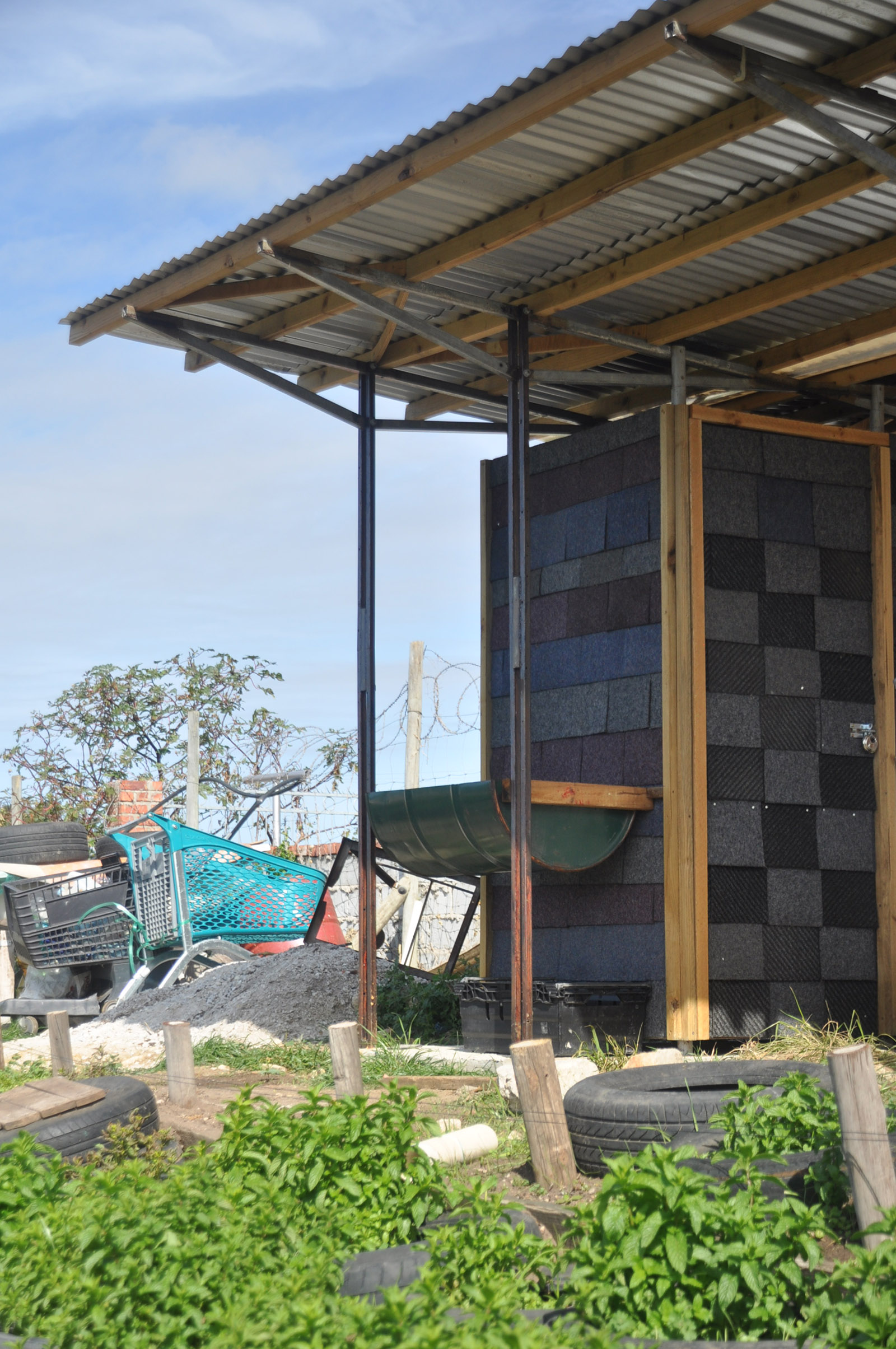The sanitary block of the Lim'uphile Co-op in Walmer, Gqeberha, is clad in recycled carpet tiles