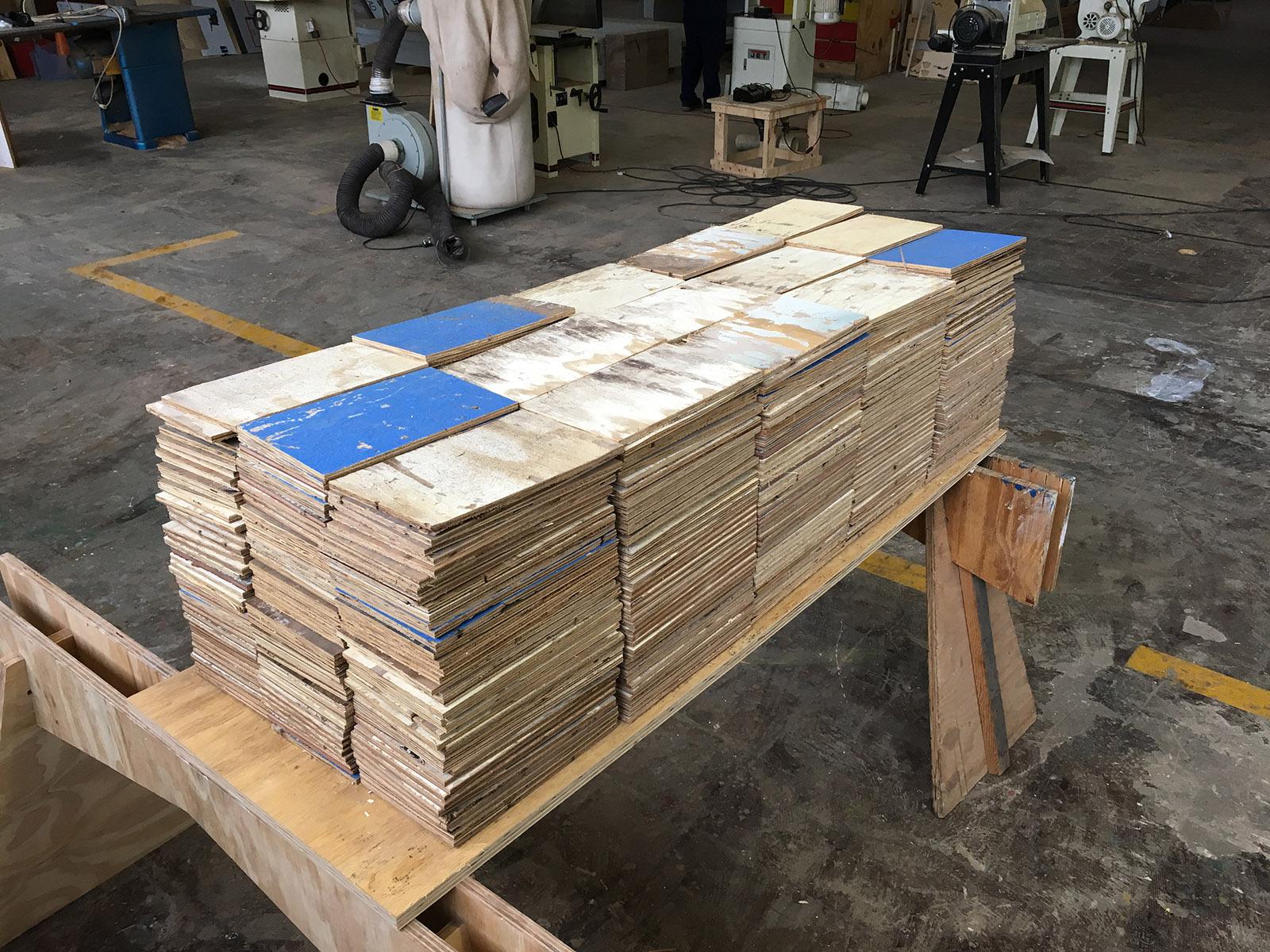 Stacks of shingles made of reused floorboards