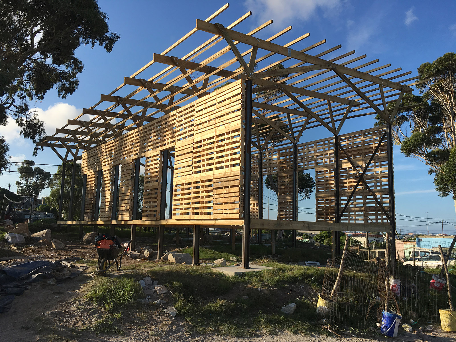 Walmer Crèche by Simon Galland with LYT Architecture under construction, showing the timber pallets